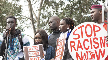 Up to 500 people took part in a protest outside Channel 7's Melbourne headquarters against what they say is 'racist' reporting of crime in the African Australian community.