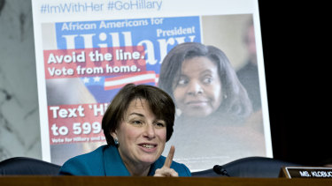 Senator Amy Klobuchar, a Democrat from Minnesota, questions witnesses in front of a Twitter post last year.
