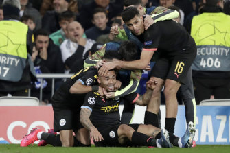 Manchester City's Gabriel Jesus celebrates with teammates after scoring their first goal against Real Madrid.