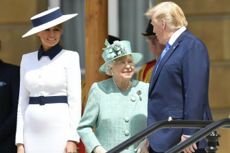 Trump and Melania attend a welcome ceremony with the Queen in the garden of Buckingham Palace.