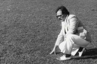 Frank Crook takes a close look at the playing surface at Belmore Sports Ground after the cancellation of a rugby league match between Canterbury and Western Suburbs in June 1980.