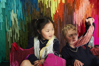 Children enjoy the wearable, touchable art of Hello, good to meet you at the MCA's Bella Room.