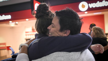 Jodie Hamilton and her daughter Mardie at Melbourne Airport on Monday afternoon.