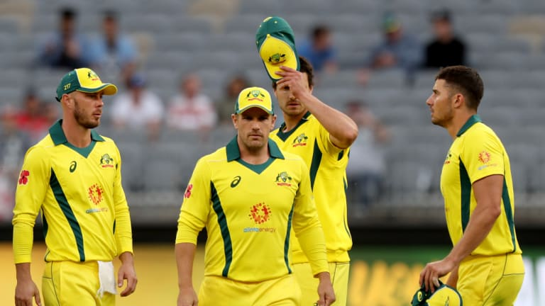 Long walk: The Australians leave the field after the heavy defeat in Perth.