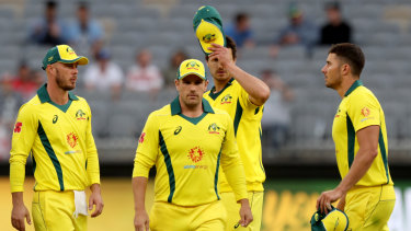 Long walk: The Australians leave the field after the heavy defeat.