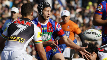 Pin-up: Kalyn Ponga directs traffic after switching to five-eighth for the Knights.