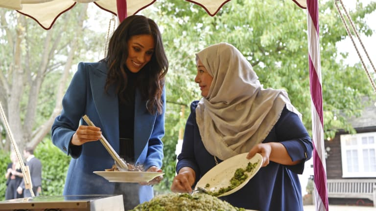 Meghan Markle helps launch the cook-book 'Together', a fundraiser for Grenfell fire victims, on September 20.