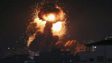 An explosion caused by Israeli airstrikes is seen from the offices of a Hamas leader on Monday. Despite a ceasefire, bombing resumed early on Tuesday.