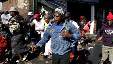 Looters make off with goods from a store in Germiston, east of Johannesburg, South Africa.
