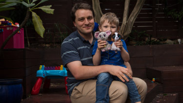 Mathematician Dr Stephen Woodcock with his five-year-old son Ben.