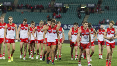 Tough sell: Most Swans supporters had left by this stage, but the lowest SCG crowd in five seasons watched last Saturday night's AFL derby in Sydney.