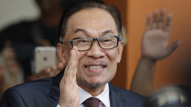 Anwar waves to supporters after his release