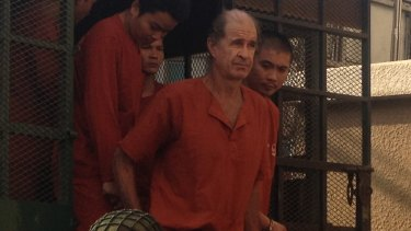 Accused Australian spy James Ricketson attends a court hearing in Phnom Penh.