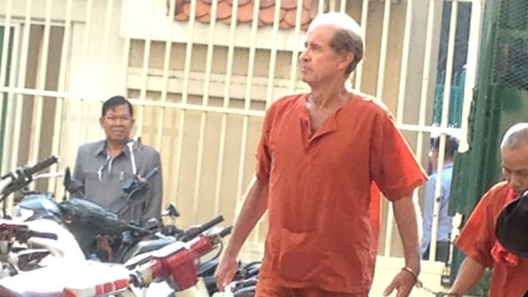 Accused Australian spy James Ricketson is led into a Cambodian court on Tuesday.