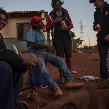 Some of Parnpajinya's remaining Martu residents sit by the fire in the centre of the town-based reserve.