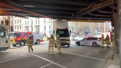 Commuter chaos after truck gets stuck under train bridge