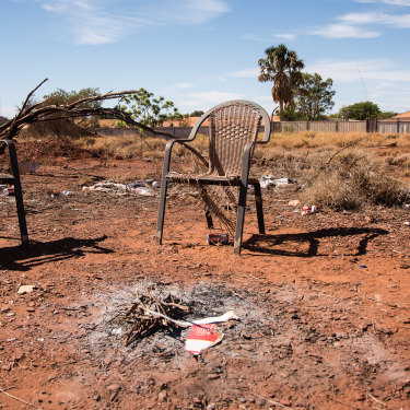 Two chairs sit by an extinguished fire in East Newman.