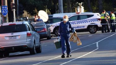 Police at the scene of the fatal shooting outside the Melbourne Pavilion in Kensington in March.