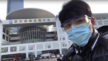 In this image from a video taken February 4, Chen Qiushi speaks in front of a convention centre-turned makeshift hospital in Wuhan.