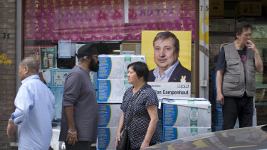 An election poster is displayed in the window of an Asian food store in Antwerp. Belgium, which has one of the oldest compulsory voting systems, will go to the polls for regional, federal and European elections on May 26.