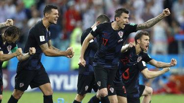 Croatia players celebrate winning the penalty shootout.
