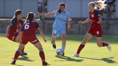Alexandra Chidiac takes on  the United defence at Marden Sports Complex, in Adelaide.