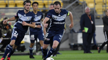 Hot-footing it: Leigh Broxham leads the charge for Victory during their round 23 loss to the Phoenix at  Westpac Stadium in Wellington.