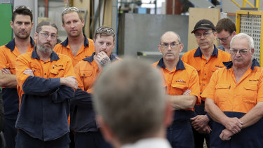 Opposition Leader Bill Shorten, talking to workers at the Volgren bus facility in Perth, will make it easier for casual workers to become permanent.