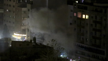An explosion caused by Israeli airstrikes is seen from a Hamas-affiliated insurance company in Gaza City.