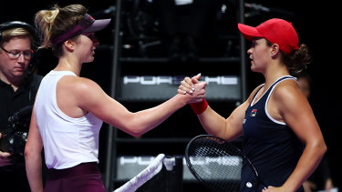 Title honours: Ashleigh Barty is congratulated by Elina Svitolina after winning the WTA Finals.