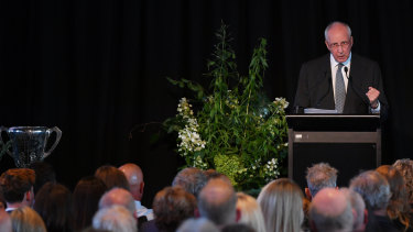 Former prime minister Paul Keating speaks at the memorial for Michael Gordon at the MCG in February. A Hawthorn premiership trophy can be seen on the left.