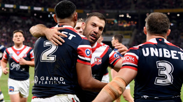 Daniel Tupou of the Roosters is congratulated by James Tedesco after scoring at Suncorp Stadium.
