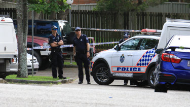 Police investigate the scene of a fatal shooting at Young Street, Petrie.