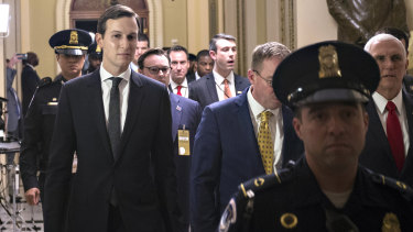 Jared Kushner, senior White House adviser, left, and US Vice President Mike Pence, right, leave following a meeting at the US Capitol.