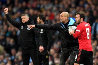 Juan Mata tried to get the ball off City coach Pep Guardiola.