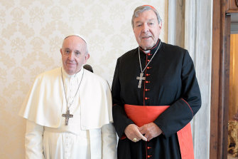 Pope Francis and Cardinal George Pell during their private meeting at the Vatican on Monday.