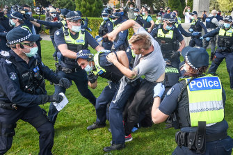A police officer and protester scuffle on Saturday.