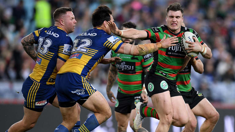 Fast Starter Angus Crichton Fends Off Tepai Moeroa Of The Eels