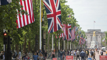 National flags of Britain and America line The Mall thoroughfare in London leading to the gilded Queen Victoria Monument standing in front of Buckingham Palace in preparation for Donald Trump's state visit.