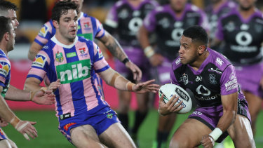Pretty in pink: Warriors tryscorer David Fusitu'a runs at Aidan Guerra last night.