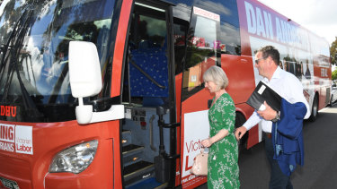 Victorian Premier Daniel Andrews and wife Catherine Andrews board the Labor bus in Noble Park on Wednesday.