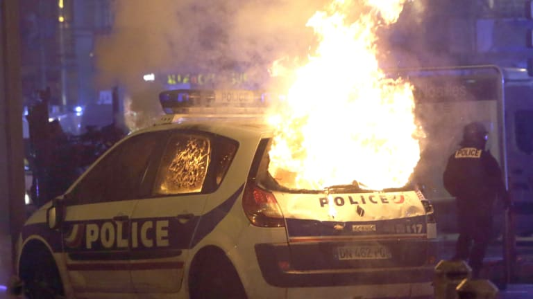 A police car burns after clashes between police and protesters in Marseille, southern France, on Saturday.