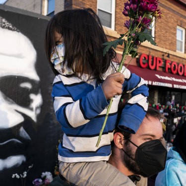 People gather outside Cup Foods in Minneapolis to celebrate the murder conviction of former police Officer Derek Chauvin in the killing of George Floyd.