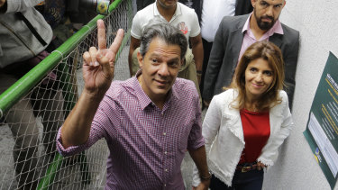 Workers' Party presidential candidate and wife Ana Estela arrive to cast their vote in Sao Paulo.