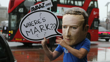 An activist wearing a Mark Zuckerberg mask stands outside the British parliamentary meeting in Westminster last year.