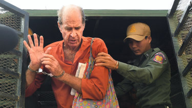Ricketson, who was accused of espionage, exits the prison van as he arrives at the Phnom Penh Municipal Court  for a court appearance.