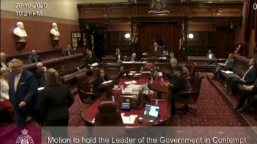 Don Harwin being escorted out of the NSW Legislative Council on Tuesday night.