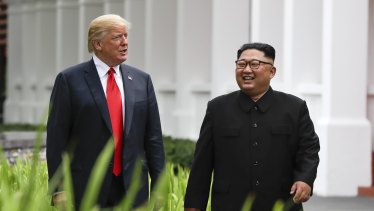 Donald Trump and Kim Jong-un walking together after lunch.