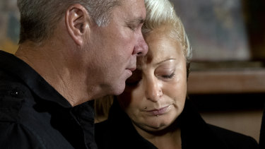 Harry Dunn's mother, Charlotte Charles, is comforted by a family member last year.