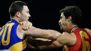 Push and shove: Eagle Jeremy McGovern clashes with the Suns' Alex Sexton during the round 2 match at Metricon Stadium on the Gold Coast.